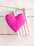 Romantic Heart On snowy Boards. Romantic checked pink needlework heart for Valentines hanging on snow white boards with copyspace Royalty Free Stock Image