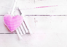 Romantic Heart On snowy Boards. Romantic checked snowy needlework heart for Valentines hanging on snow white boards with copyspace Stock Images