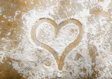 Romantic heart in sprinkled flour Royalty Free Stock Image