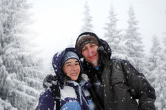 Romantic hiking couple embracing in the winter mountains stock photos