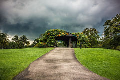 Romantic hilltop cottage resort. With thunderstorm clouds on sky Stock Images