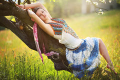 Romantic hippie posing in spring meadow stock images