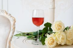 Romantic holiday composition with wine glass and roses for Valentines Day. Love, gift and spring holiday background. royalty free stock images