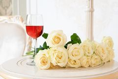 Romantic holiday composition with wine glass and roses for Valentines Day. Love, gift and spring holiday background.
