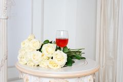 Romantic holiday composition with wine glass and roses for Valentines Day. Love, gift and spring holiday background. stock photos