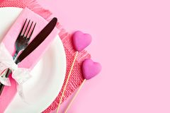 Romantic holiday table setting. Selective focus. Horizontal. Top view. Background with copy space. Romantic holiday table setting. Card for St. Valentine`s Day royalty free stock photo