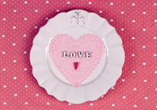 Romantic holiday table setting, on fabric heart pattern Royalty Free Stock Images