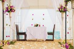 Romantic honeymoon dining place on the beach Stock Photo