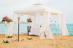 Romantic honeymoon dining place on the beach Stock Photos