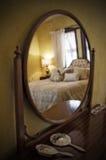 Romantic Hotelroom. Romantic bed with pillows seen through a mirror Stock Photos