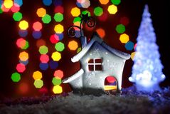 Romantic house with a Christmas illumination Stock Photos