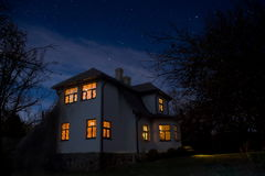 Romantic house with a light in the window. Night landscape in summer Royalty Free Stock Photography