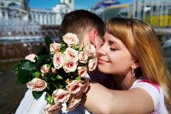 Romantic hug the guy and girl. On lovers dating Stock Photos