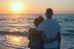 Romantic hugging couple enjoy the sunset on the beach Royalty Free Stock Photo