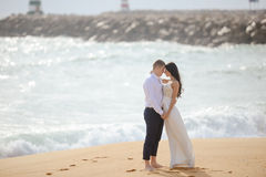 Romantic hugging loving couple on the beach Stock Photography