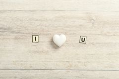 Romantic I Love You message on wood. With a central white ornamental heart and copy space below for a Valentine greeting to your sweetheart royalty free stock photo