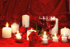 Romantic Image with Wine and Candles. Romantic Valentine image with romantic Candles, two glasses of wine all against red silk and red roses Royalty Free Stock Image