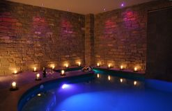 Romantic indoor spa pool Stock Photos