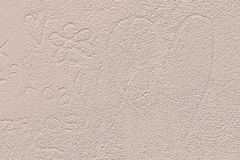 Symbol of heart and flower scribbled on beige plastered wall. Romantic inscription scrawled on concrete wall. Perfect for love concept, Valentine s Day, ideal royalty free illustration