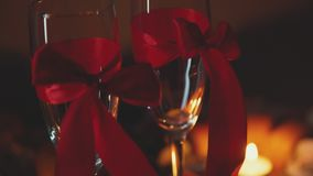 Romantic Interior: dim lights, candles, two glasses of champagne. Slowmotion. A date for Valentine`s Day. Erotic atmosphere for a romantic pastime loving couple stock video footage