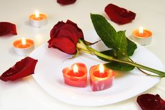 Romantic Inviting Table with Rose and Candles Stock Images