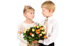 Romantic kids looking at each other with love Stock Image