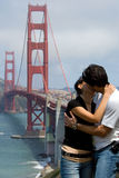 Romantic kiss. Couple with Golden Gate bridge on background Royalty Free Stock Image