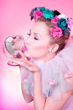 Romantic kiss. A pinup girl sending a blow kiss, reflection in the mirror stock photo