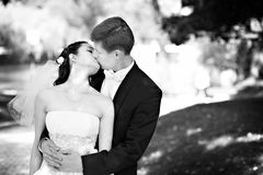 Romantic kiss bride and groom Stock Photo