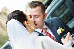 Romantic kiss bride and groom. Romantic kiss the bride and groom at a wedding walk Stock Images