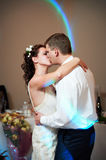 Romantic kiss bride and groom Royalty Free Stock Image