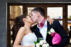 Romantic kiss bride and groom Royalty Free Stock Photo