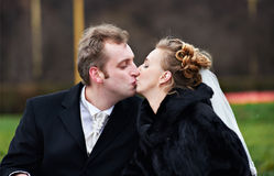 Romantic kiss bride and groom. On wedding walk Royalty Free Stock Images