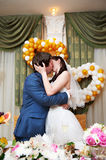 Romantic kiss bride and groom in banquet Royalty Free Stock Photo