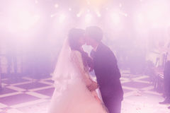 Romantic kiss of the bride and groom on the dancefloor.  Royalty Free Stock Photo