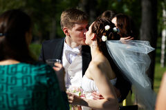 Romantic kiss bride and groom at wedding walk Royalty Free Stock Photos