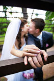 Romantic kiss bride and groom Royalty Free Stock Photography