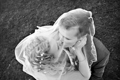 Romantic kiss happy bride and groom. At the wedding walk Royalty Free Stock Image