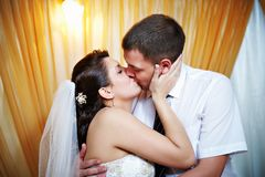 Romantic kiss happy bride and groom Royalty Free Stock Photography
