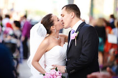 Romantic kiss happy bride and groom Stock Image