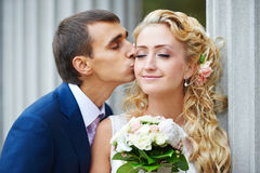Romantic kiss happy bride and groom Royalty Free Stock Images