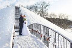 Romantic kiss happy bride and groom on winter day Royalty Free Stock Photography