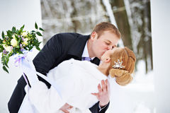 Romantic kiss happy bride and groom Stock Photo