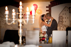 Romantic kiss of married couple Stock Photos