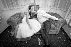 Romantic kiss of married couple Stock Image