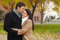 Romantic kiss in a park Royalty Free Stock Photo