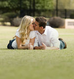 Romantic kiss in park. A couple share a romantic kiss in a park