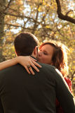Romantic kiss between young couple in woods Royalty Free Stock Photo