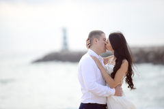 Romantic kissing loving couple on the beach Royalty Free Stock Images