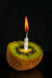 Romantic kiwi -shaped candle Royalty Free Stock Image